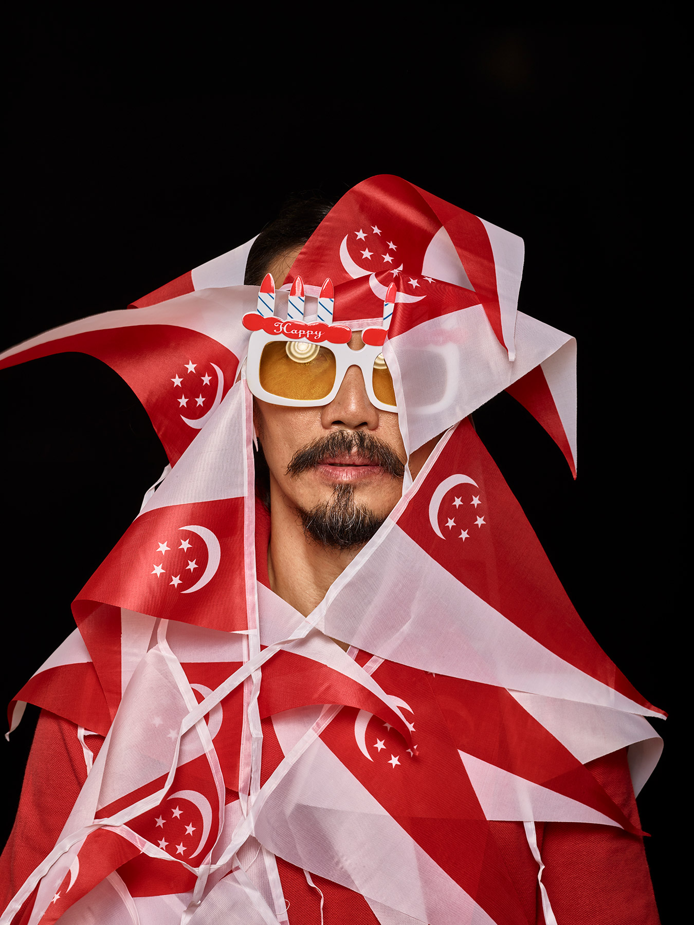 9 Aug 2017 Derong is wearing party shades and has a string of Singapore flags all over him
