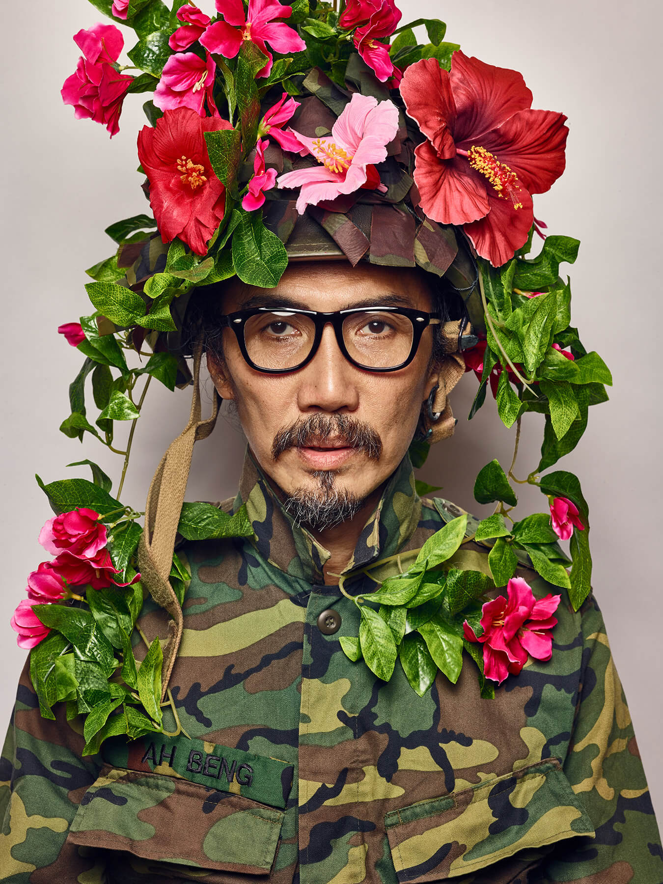 2 Aug 2017 Derong is in army uniform and has on fake bright flowers as camouflage