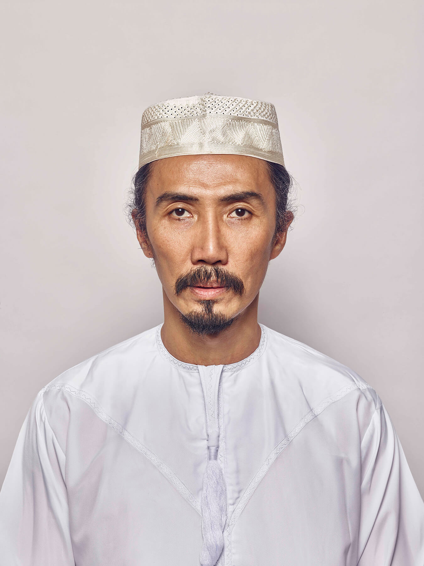 1 Sep 2017: Derong is photographed wearing traditional Muslim men's clothing
