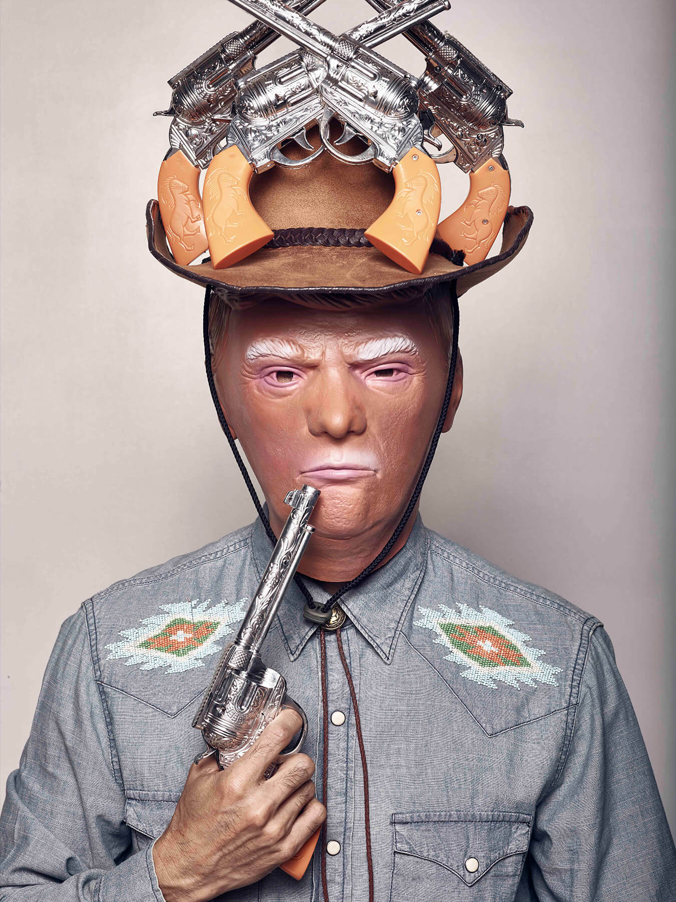 28 Aug 2017: Derong is photographed as Donald Trump and holding a pistol to his lip