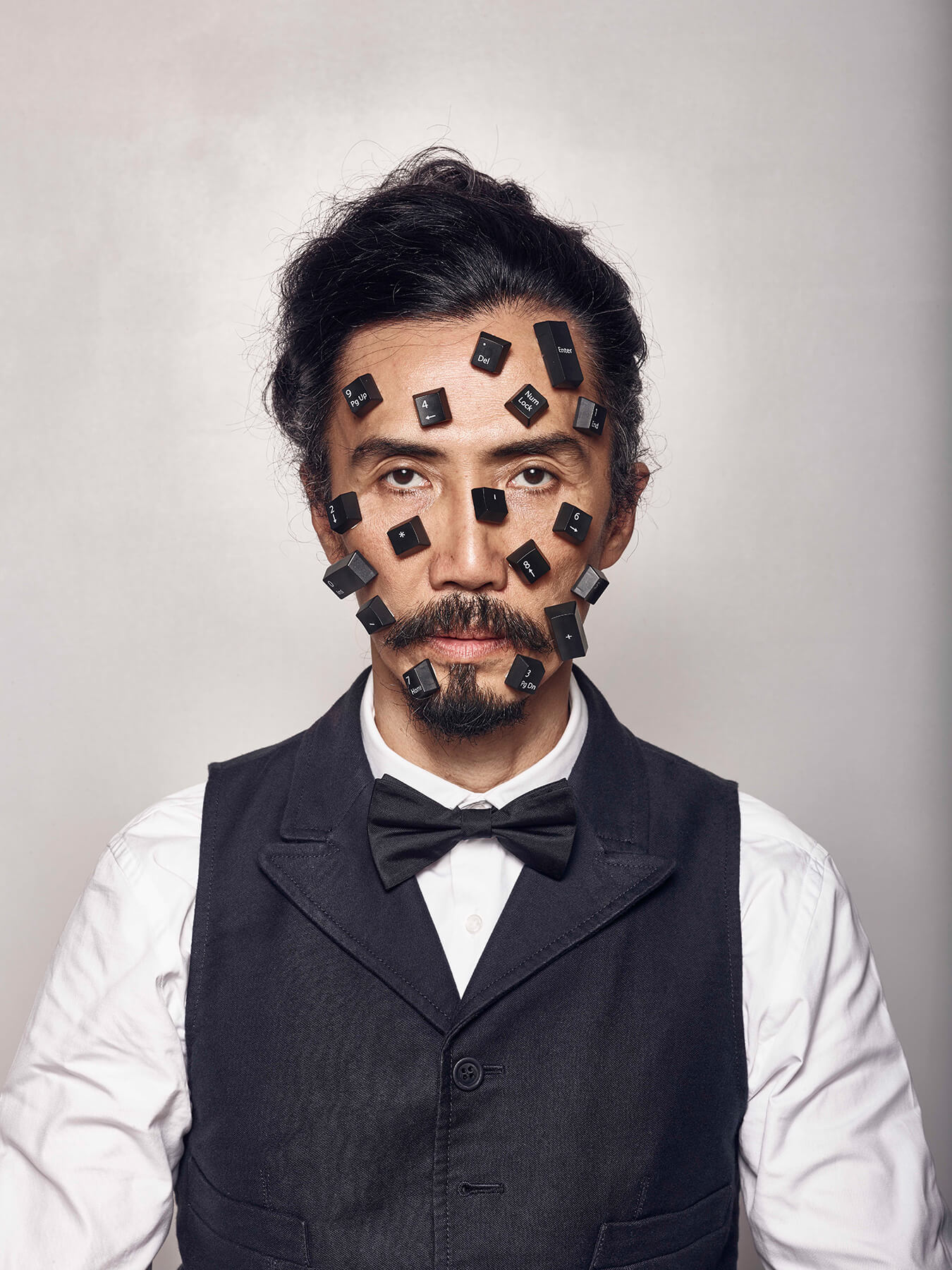 6 Sep 2017: Derong is photographed with stray keyboard keys all over his face