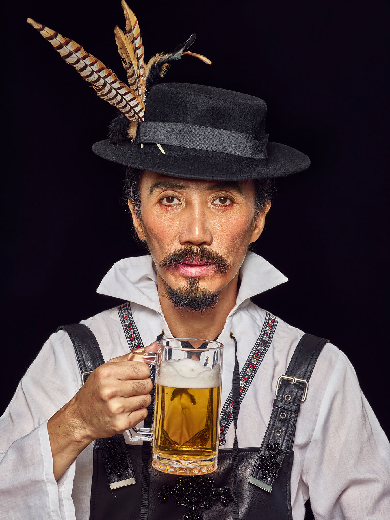 17 Sep 2017: Derong is dressed in traditional oktoberfest costume and holding a beer