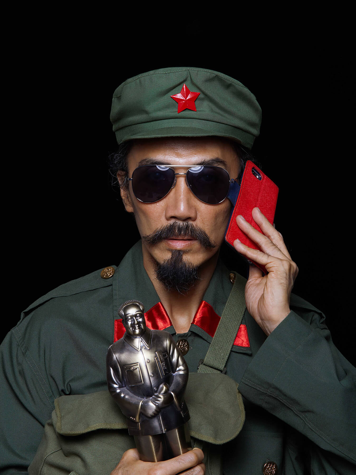 1 Oct 2017 - CHINESE GOLDEN WEEK: Derong is dressed in Chinese military uniform holding a Mao figurine and red handphone