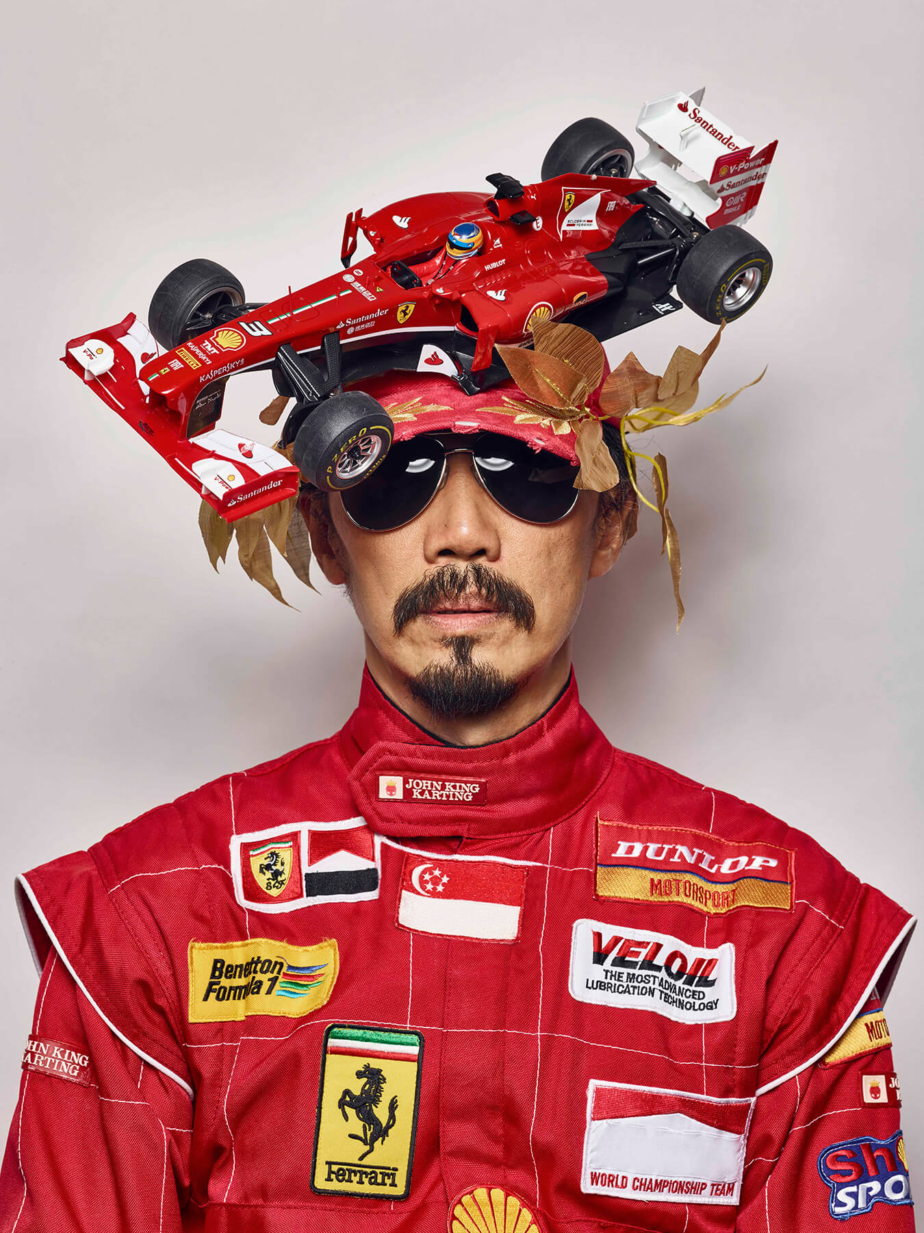 9 Sep 2017: Derong is dressed in F1 racing gear, with an F1 racing car model on his head