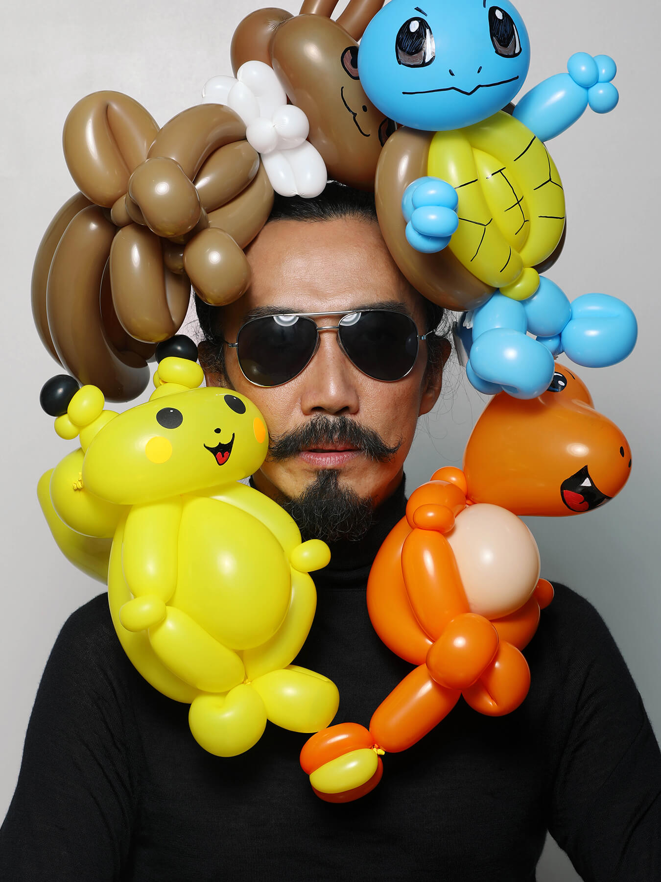11 Oct 2017 Pokemon: Derong is photographed with Pokemon twist balloons